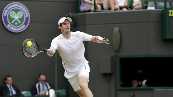 Andy Murray of Britain hits a shot during his match against Robin Haase of the Netherlands at the Wimbledon Tennis Championships in London