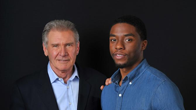 "In this Saturday, March 23, 2013 photo, Harrison Ford. left, and Chadwick Boseman, cast members in the new film ""42,"" pose together for a portrait, in Los Angeles. Harrison Ford isn't ""yet"" ready to talk about Disney's planned ""Star Wars"" sequel, but he will praise its director, J.J. Abrams. The 70-year-old actor -- who came to fame playing Han Solo in the sci-fi trilogy -- is shrugging off questions about that character while promoting his role as Brooklyn Dodgers president Branch Rickey in the Jackie Robinson film ""42."" (Photo by Chris Pizzello/Invision/AP)"