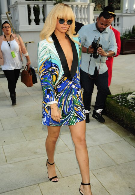 Celebrity fashion: Rihanna appeared nearly naked in a Stella McCartney marble-print jacket-dress. Her lean legs were on show but all attention was on that plunging neckline. RiRi is a brave girl!
