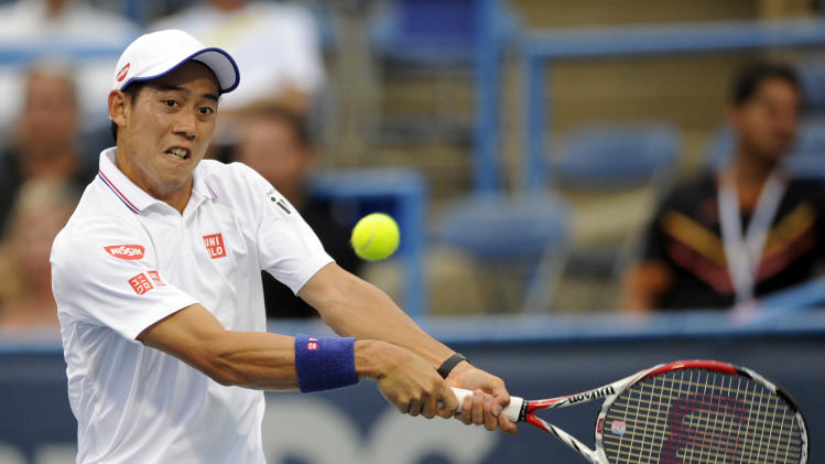 Kei Nishikori, of Japan, returns the ball against Richard Gasquet, of France, during a match at the Citi Open tennis tournament, Friday, Aug. 1, 2014, in Washington. (AP Photo/Nick Wass)