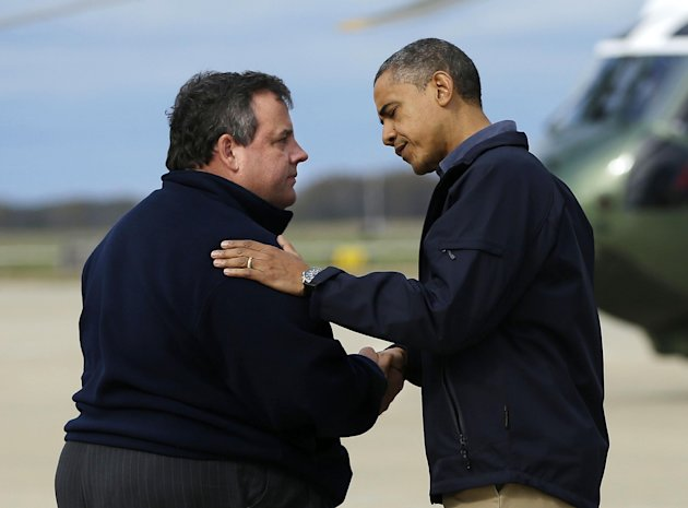 President Barack Obama is greeted by New Jersey Gov. Chris Christie upon his arrival at Atlantic City International Airport, Wednesday, Oct. 31, 2012, in Atlantic City, NJ. Obama traveled to region to