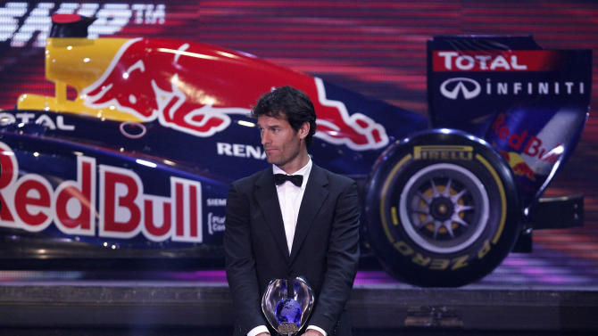 Red Bull Formula One driver Mark Webber of Australia poses with his FIA trophy during the 2011 FIA Gala awards ceremony night in Gurgaon, some 35 kilometers (22 miles) west of New Delhi, India, Friday, Dec. 9, 2011. This is the first time India is hosting the awards gala, which has over the years been traditionally held in the French Principality of Monaco. (AP Photo/Parivartan Sharma, Pool)