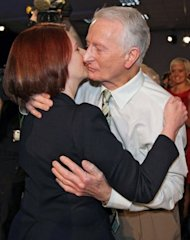 Australian PM Julia Gillard (left) hugs her father during a 2010 Labor Party campaign rally in Brisbane. Gillard said she would leave APEC talks in Russia early because her elderly father had passed away at home