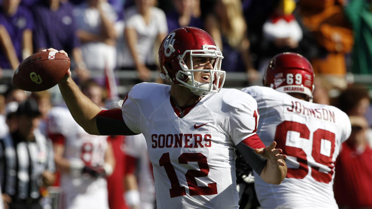 Oklahoma quarterback Landry Jones (12) passes against TCU during the first half of an NCAA college football game, Saturday, Dec. 1, 2012, in Fort Worth, Texas. (AP Photo/Tony Gutierrez)