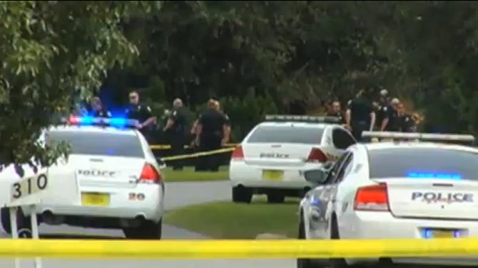 In this Sunday, Sept. 30, 2012 image made from video and provided by WKMG-TV, authorities investigate the scene of a shooting, in Winter Springs, Fla. Authorities in central Florida say two members of a motorcycle club died and a third was critically injured when gunfire erupted in the parking lot of a Veterans of Foreign War post Sunday morning as a charity ride was getting under way. (AP Photo/WKMG-TV)