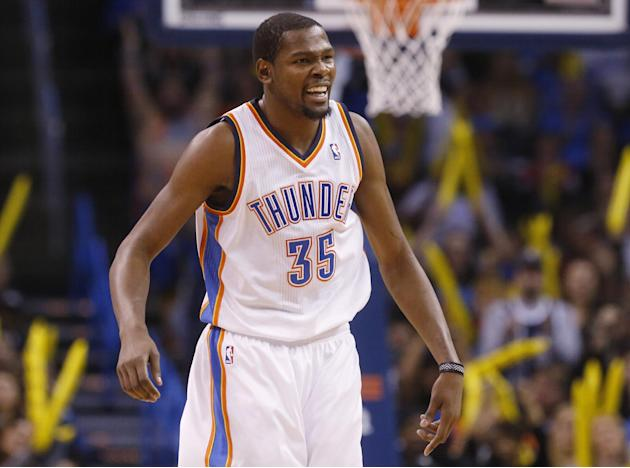 Oklahoma City Thunder forward Kevin Durant (35) celebrates following a basket by teammate Kendrick Perkins in the second quarter of an NBA basketball game against the Indiana Pacers in Oklahoma City,