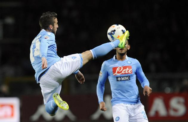 Napoli's Mertens controls an aerial ball next to Ghoulam during their Italian Serie A soccer match against Torino FC in Turin