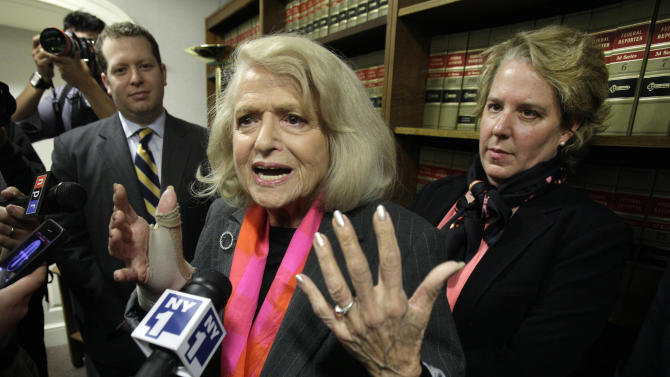 Edith Windsor, center, is interviewed at the offices of the New York Civil Liberties Union, in New York, Thursday, Oct. 18, 2012. A federal appeals court in Manhattan has become the second in the nation to strike down the Defense of Marriage Act as unconstitutional. The ruling came in a case brought by Windsor. She sued the government in November 2010 because she was told to pay $363,053 in federal estate tax after her partner of 44 years died in 2009. Her attorney Roberta Kaplan is at right. (AP Photo/Richard Drew)