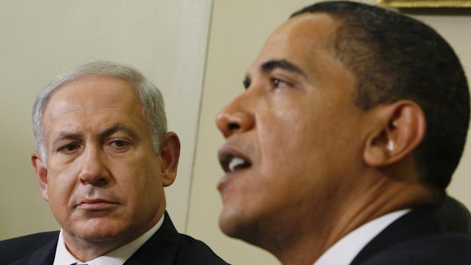 FILE -- In this Monday, May 18, 2009 file photo, Israeli Prime Minister Benjamin Netanyahu, right, looks towards President Barack Obama as he speaks to reporters in the Oval Office of the White House in Washington. President Barack Obama's vow to take his message straight to the public during his first presidential visit to Israel next week will be a tough sell with many Israelis who consider him naive, too soft on the nation's enemies and even hostile to Prime Minister Benjamin Netanyahu. (AP Photo/Charles Dharapak, File)