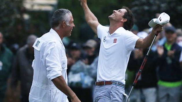 Adam Scott of Australia (R) celebrates with caddie Steve Williams after winning the 2013 Masters golf tournament on the second playoff hole at the Augusta National Golf Club in Augusta, Georgia (Reuters)