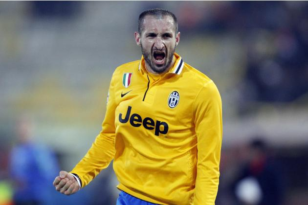 Juventus' Chiellini celebrates after scoring against Bologna during their Italian Serie A soccer match at the Dall'Ara stadium in Bologna