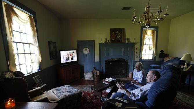 This photo taken Oct. 10, 2012 shows Virginia voter Harry Donahue and his wife Nancy watching a news show in the living room of their farmhouse, house, built in the 1700's, in Farmville, Va.  Donahue, a 68-year-old retired chemical worker from Philadelphia's New Jersey suburbs, moved to Virginia in 2001 and brought with him an independent streak and a voting pattern that ranges from Ronald Reagan to Ross Perot. He plans to back Obama this year after supporting John McCain in 2008.  (AP Photo/Steve Helber)