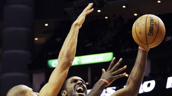 Houston Rockets' Patrick Patterson (54) goes to the basket against Miami Heat's Shane Battier (31) in the second half of an NBA basketball game, Monday, Nov. 12, 2012, in Houston. The Heat won 113-110.(AP Photo/Pat Sullivan)