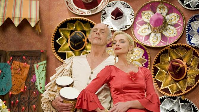 """This film image released by Kenn Viselman Presents, Inc. shows actors Christopher Lloyd as Lero Sombrero, left, and Jaime Pressly as Lola in a scene from """"The Oogieloves in the Big Balloon Adventure."""" (AP Photo/Kenn Viselman Presents, Inc., Matthew Mitchell)"""