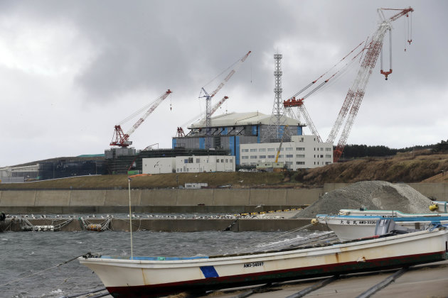 In this Nov. 9, 2012 photo, cranes stand around the Oma nuclear power plant in Oma in Aomori, northern Japan. In nearby Oma, construction is set to resume on an advanced reactor that is not a fast-bre