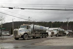 A line of trucks carrying water to Natural gas rigs in Monroeton Pennsylvania
