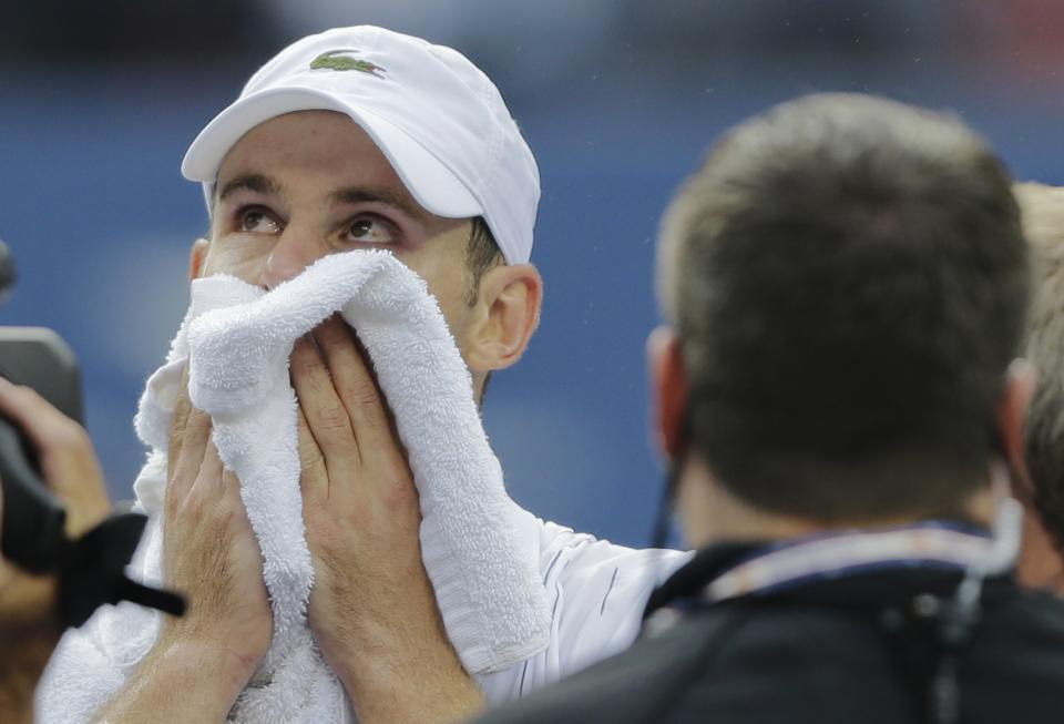 Andy Roddick wipes his face after loosing to Argentina's Juan Martin Del Potro in the fourth round of play at the 2012 US Open tennis tournament,  Wednesday, Sept. 5, 2012, in New York. Roddick said he would retire after the match. (AP Photo/Mike Groll)