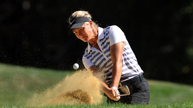 Suzann Pettersen, of Norway, hits a shot out of a bunker on the fifth hole during the final round of the LPGA Safeway Classic golf tournament in Portland, Ore., Sunday, Sept. 1, 2013. Pettersen shot a 5 under par 67 to win the tournament. (AP Photo/Steve Dykes)