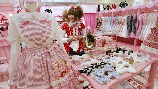 File photo of a shop attendant dressed in lolita fashion working in a shop at Marui One in Tokyo