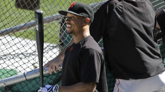 San Francisco Giants second baseman Emmanuel Burriss stands near the cage during batting practice before the Giants' baseball game against the Colorado Rockies on Sunday, Sept. 18, 2011, in Denver. (AP Photo/Barry Gutierrez)
