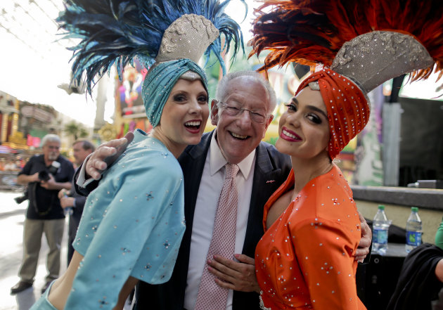 Oscar Goodman poses for photos with two showgirls before kicking off a car show at the Fremont Street Experience, 105Friday, May 17, 2013, in Las Vegas. The former Las Vegas mayor branded the city wit