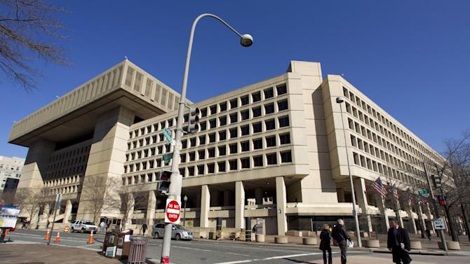 """FILE - This Feb. 3, 2012 file photo shows Federal Bureau of Investigation (FBI) headquarters in Washington. Just six blocks from the White House, the FBI's hulking headquarters overlooking Pennsylvania Avenue has long been the government building everyone loves to hate. The verdict: it's an ugly, crumbling concrete behemoth. An architectural mishap, all 2.4 million square feet of it. But in this time of tight budgets, massive deficits and the """"fiscal cliff,"""" the 38-year-old FBI headquarters building has one big thing in its favor. It sits atop very valuable real estate, an entire city block on American's Main Street midway between the U.S. Capitol and the White House. Just how valuable, the General Services Administration intends to find out. (AP Photo/Manuel Balce Ceneta, File)"""