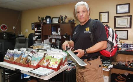 Founder of the HomeSafety Academy D'Eugenio poses with his supplies in Lake Park