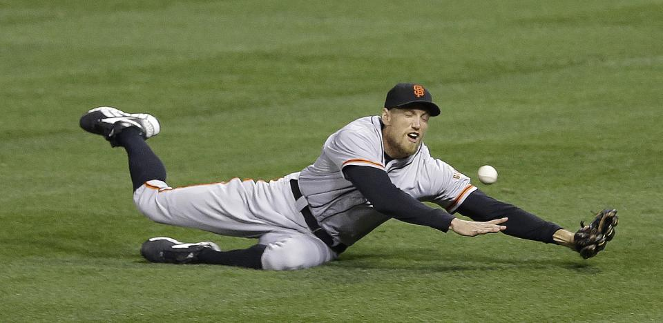 San Francisco Giants right fielder Hunter Pence can't come up with a double hit by St. Louis Cardinals' David Freese during the second inning of Game 5 of baseball's National League championship series, Friday, Oct. 19, 2012, in St. Louis. (AP Photo/Patrick Semansky)