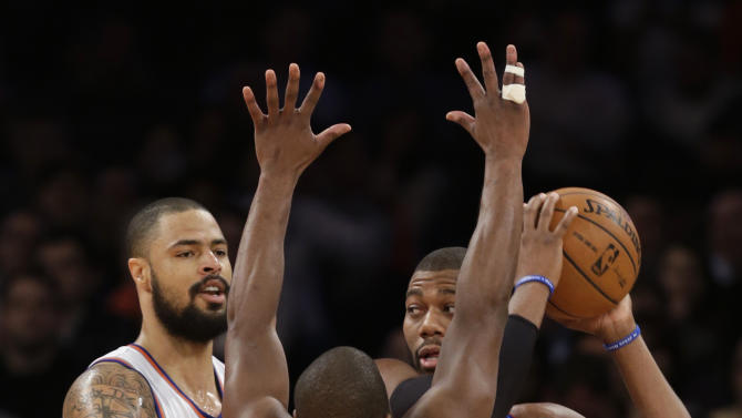 New York Knicks center Tyson Chandler (6) and guard Raymond Felton (2) defend Detroit Pistons center Greg Monroe (10) in the first half of an NBA basketball game at Madison Square Garden in New York, Monday, Feb. 4, 2013. (AP Photo/Kathy Willens)