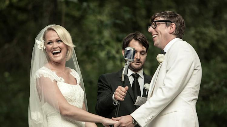 "This Saturday, Sept. 15, 2012 photo released by Joshua Black Wilkins shows Patrick Carney of The Black Keys, right, with his bride Emily Ward at their wedding officiated by actor Will Forte, center, at the couple's home in Nashville, Tenn.  The Keys' publicist says the couple was joined by about 350 family and friends for the back-yard ceremony. Comedian Will Forte officiated the wedding. Ward wore a dress by Carolina Herrera and walked down the aisle to ""Crimson and Clover"" by Tommy James & The Shondells. (AP Photo/Joshua Black Wilkins)"