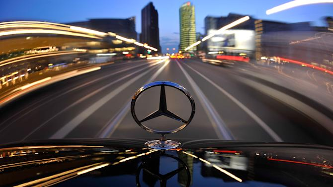 FILE - In this April 7, 2009 file photo, the star emblem on the hood of a Mercedes-Benz car produced by Daimler is seen near Potsdam Square, Potsdamer Platz, in Berlin. German automaker Daimler AG said Wednesday, Oct. 24, 2012 its net profit in the third quarter declined 11 percent to euro 1.20 billion ($1.6 billion) from euro 1.36 billion a year ago. The company says overall revenues rose by 8 percent to euro 28.6 billion thanks to stronger sales of its Mercedes Benz luxury cars. (AP Photo/Gero Breloer, File)