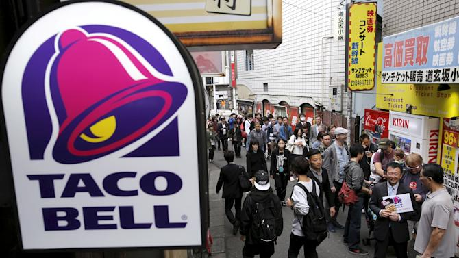 File photo of people lining-up for the first Taco Bell fast-food restaurant in Japan at Tokyo's Shibuya shopping district