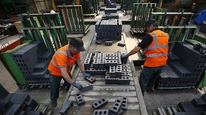 Workers pack bricks at the Wienerberger Brick Factory in Dosthill