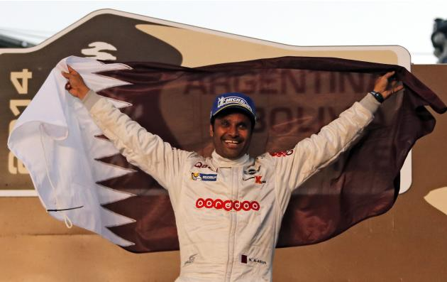 Third-placed Al-Attiyah of Qatar celebrates on the podium after the sixth South American edition of the Dakar rally 2014 in the car category in Valparaiso