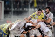 Bordeaux's Francois Tisseau (R) vies with Clermont's Loic Jaquet (2nd R) during the French Top 14 rugby union match Bordeaux-Begles vs Clermont on December 21, 2012