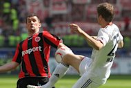 Frankfurt&#39;s Czech striker Martin Fenin (left) vies for the ball with Bayern Munich&#39;s midfielder Thomas Mueller during a match at the Commerzbank Arena in Frankfurt/M, 2011. Eintracht Frankfurt will join Bavarian side Greuther Fuerth in the German league next season following their 3-0 win over Alemannia Aachen with Cameroon striker Mohamadou Idrissou scoring twice