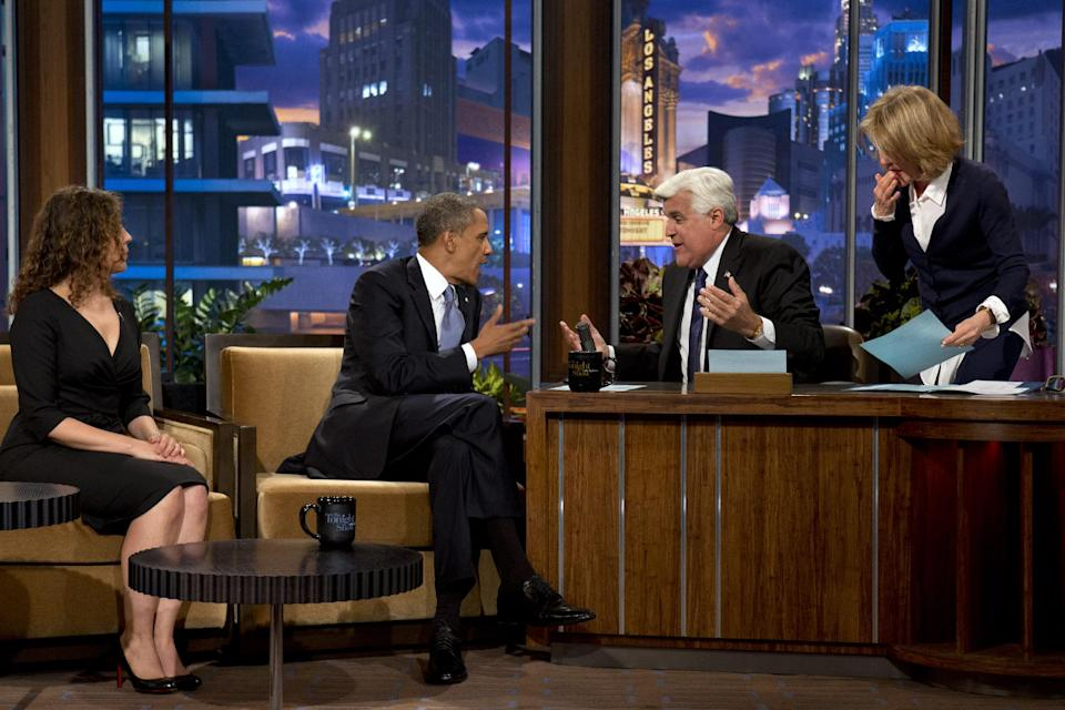 "President Barack Obama talks with Jay Leno during a commercial break during the taping of his appearance on ""The Tonight Show with Jay Leno"" in Los Angeles, Tuesday, Aug. 6, 2013. (AP Photo/Jacquelyn Martin)"