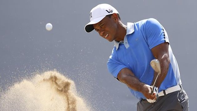 Tiger Woods of the U.S. hits out of the bunker on the 18th hole during the Pro-Am round of the BMW Championship (Reuters)