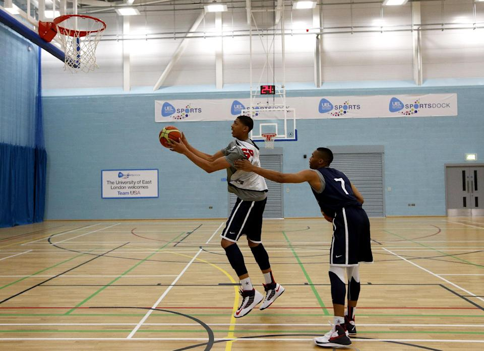 United States forward Anthony Davis, left, drives to the basket past Russell Westbrook during a men's team basketball practice at the 2012 Summer Olympics, Saturday, July 28, 2012, in London. (AP Photo/Jae C. Hong)