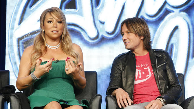 """Mariah Carey and Keith Urban from """"American Idol"""" attend the Fox Winter TCA Tour at the Langham Huntington Hotel on Tuesday, Jan. 8, 2013, in Pasadena, Calif. (Photo by Todd Williamson/Invision/AP)"""