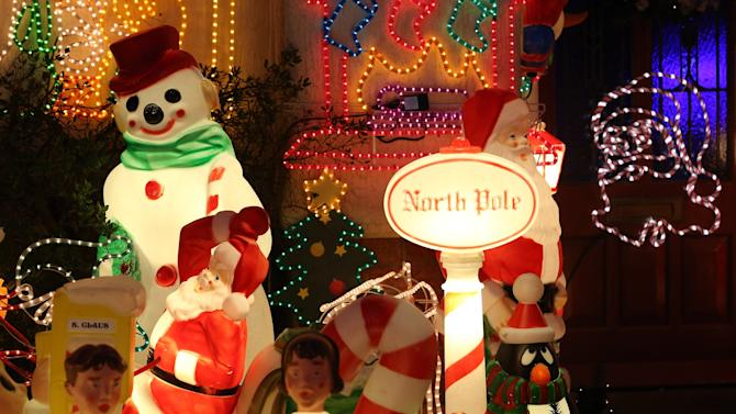 Homeowners Decorate Their Houses For Christmas