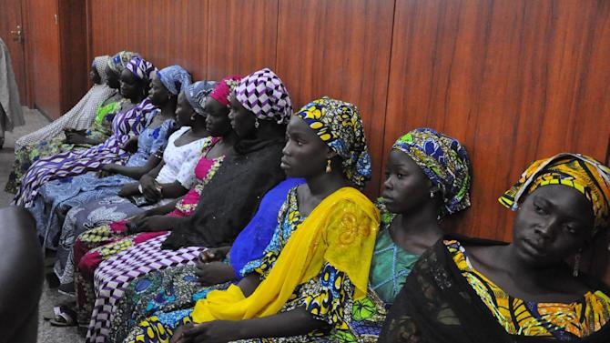 "Some of the escaped Kidnapped girls of the government secondary school Chibok, attend a meeting with Borno state governor, Kashim Shettima, in Maiduguri, Nigeria, Monday, June 2, 2014. Nigerian police say they have banned protests in the capital demanding that the government rescues the more than 200 girls still held captive by Boko Haram militants. Altine Daniel, a spokeswoman for Abuja police confirmed the ban in a text message, saying it was ""because of security reasons"". (AP Photo/Jossy Ola)"