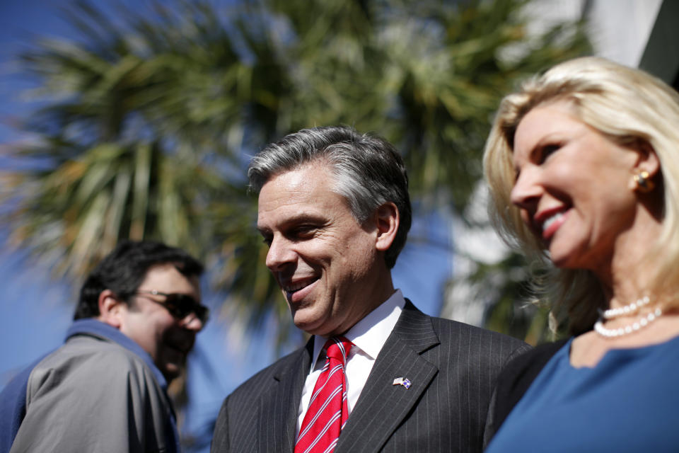 Republican presidential candidate, former Utah Gov. Jon Huntsman, accompanied by his wife Mary Kaye, right, after a campaign stop at Virginia's on King restaurant, Sunday, Jan. 15, 2012, in Charleston, S.C. (AP Photo/Matt Rourke)