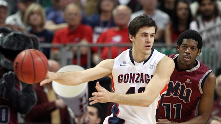 Gonzaga's Drew Barham passes as Loyola Marymount's Nick Stover defends during the first half of a West Coast Conference tournament NCAA college basketball game on Saturday, March 9, 2013, in Las Vegas. (AP Photo/Isaac Brekken)