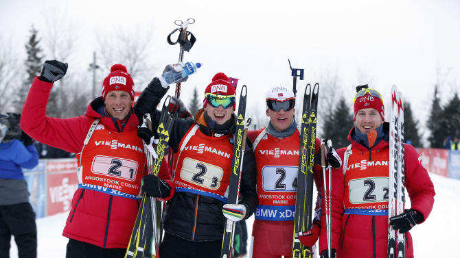 Norway's winning team, from left, Lars Helge Birkland,  Johannes Thingies Bow, Tarjei Boe, and Eriend Bjoentegaard pose after their victory in the relay competition at the World Cup Biathlon, Saturday, Feb. 13, 2016, in Presque Isle, Maine. (AP Photo/Robert F. Bukaty)