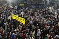 Jamaat-e-Islami activists take to the streets during a rally in Dhaka on February 4, 2013. A Bangladeshi court sentenced a senior Islamist opposition official to life in prison Tuesday for mass murder and crimes against humanity during the 1971 liberation war against Pakistan