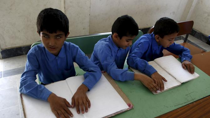 Visually impaired boys learn to read braille at the Government School and Institute for the Blind in Peshawar