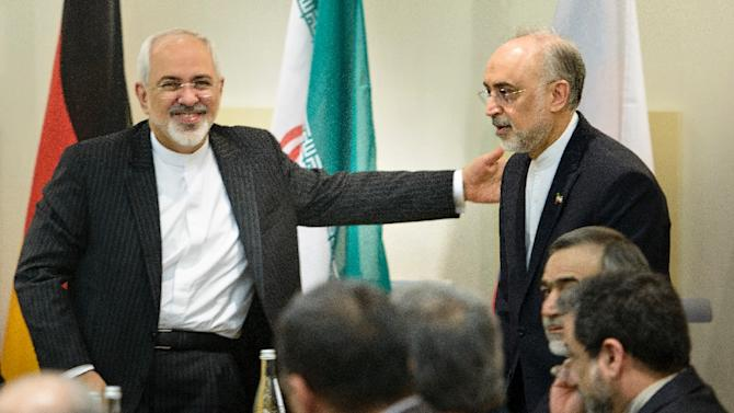 Iranian Foreign Minister Mohammad Javad Zarif (L) greets Atomic Energy Organization of Iran head Ali Akbar Salehi at the Beau Rivage Palace Hotel on March 31, 2015 in Lausanne