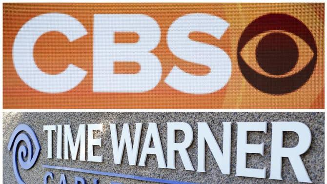Combination file photos of CBS and Time Warner logos