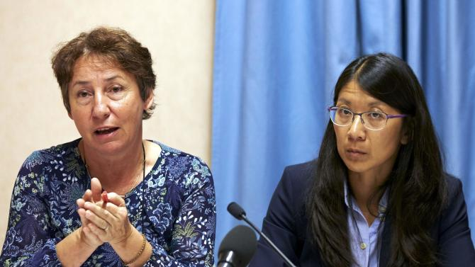 Saulnier MSF legal counsel gestures next to Liu President of MSF International during a news conference in Geneva